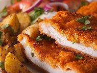 Рецепта Сочни свински шницели от филе (карета, пържоли) панирани в яйца и галета печени на фурна